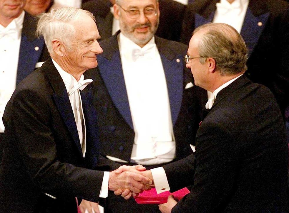 William Knowles (left) receives the Nobel Prize in chemistry from King Carl XVI Gustaf of Sweden