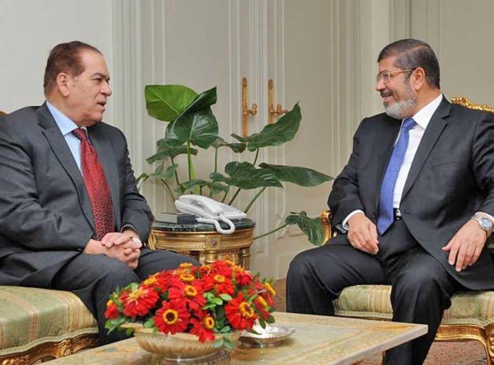 President-elect Mohamed Morsi, right, meeting Prime Minister Kamal al-Ganzuri yesterday