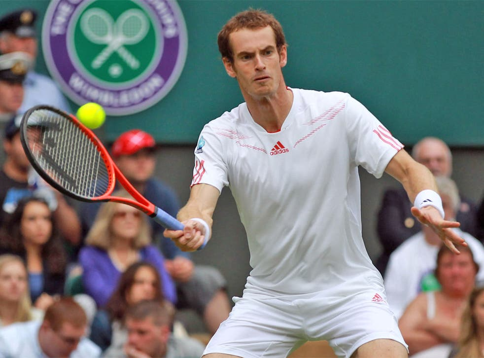 Andy Murray in action at Wimbledon on Tuesday - where he was supported by a large entourage