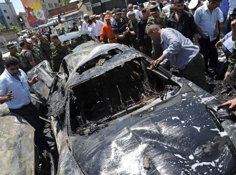 An explosion outside the Palace of Justice in central Damascus