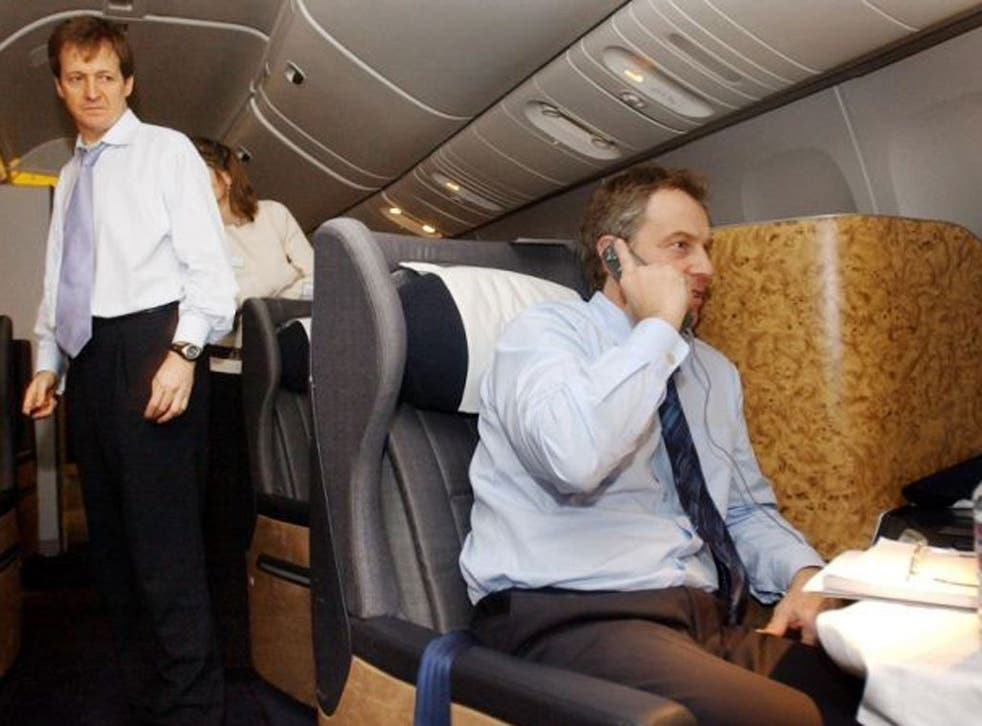 British Prime Minister Tony Blair, center, watched by his director of Communications and Strategy, Alastair Campbell, left, speaks to the Foreign Secretary Jack Straw on the telephone duing his flight back from the Azores, Sunday, March 16, 2003, after a summit meeting with President Bush and Spanish Prime Minister Jose Maia Aznar where they discussed the future of action to disarm Iraq.