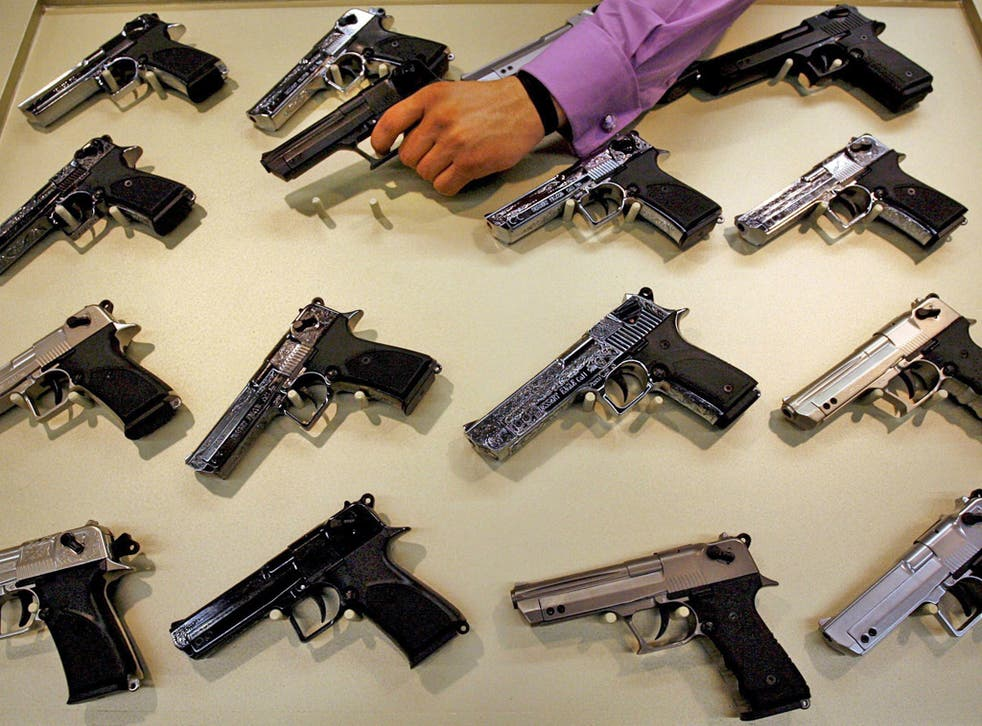Guns for sale at a trade fair in Nuremberg, Germany, with 1,050 exhibitors from 51 countries