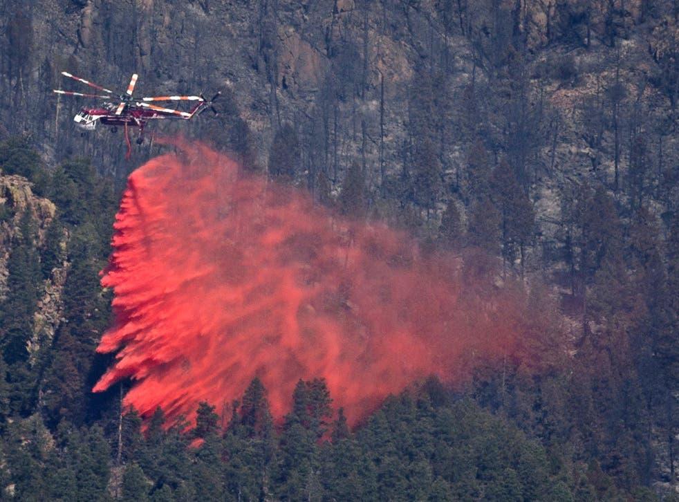 A helicopter drops fire retardant onto the Waldo Canyon Fire in Colorado Springs yesterday