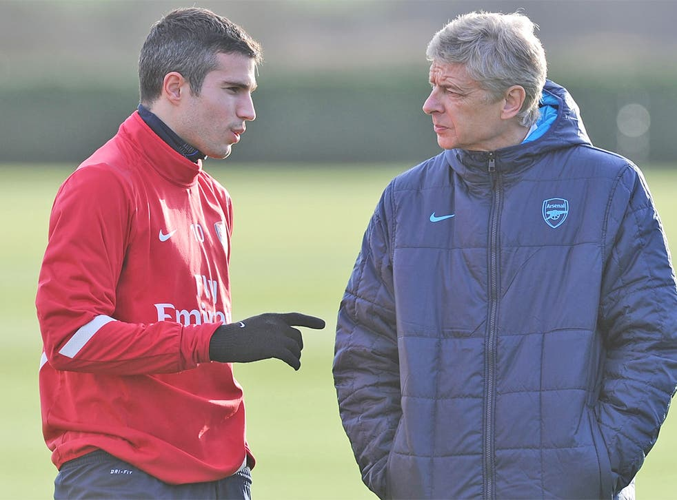 Robin van Persie and Arsene Wenger are on a different page