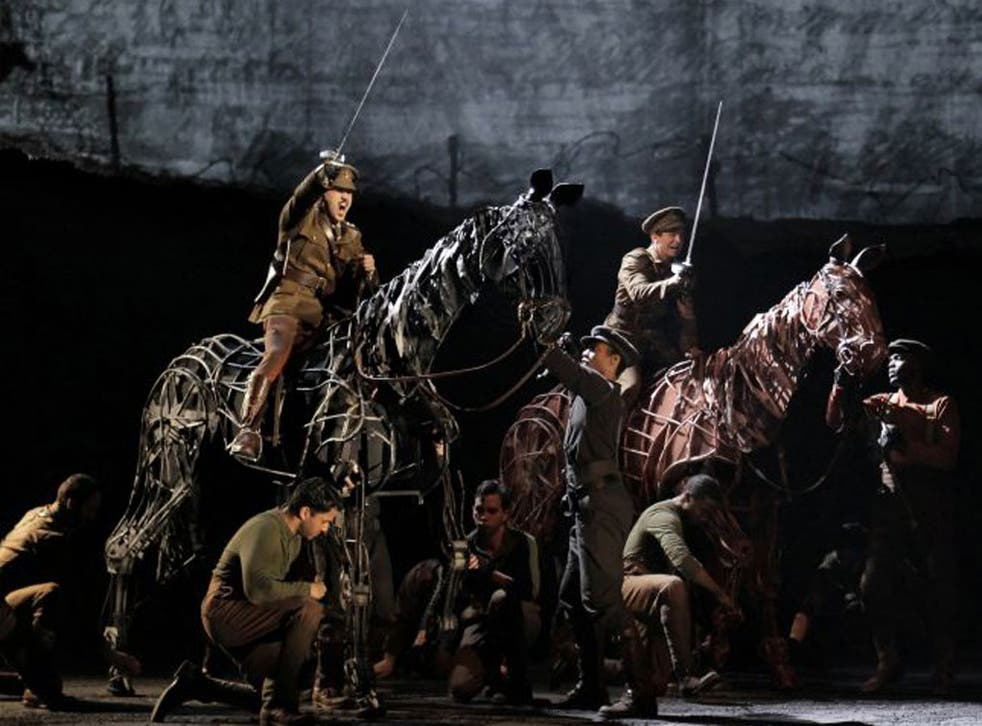 """FILE - In this file theater publicity image provided by Lincoln Center Theater, a scene is shown from the production of """"War Horse,"""" performing at the Lincoln Center Theater in New York. """"War Horse"""" was the No. 2 movie in 2011."""