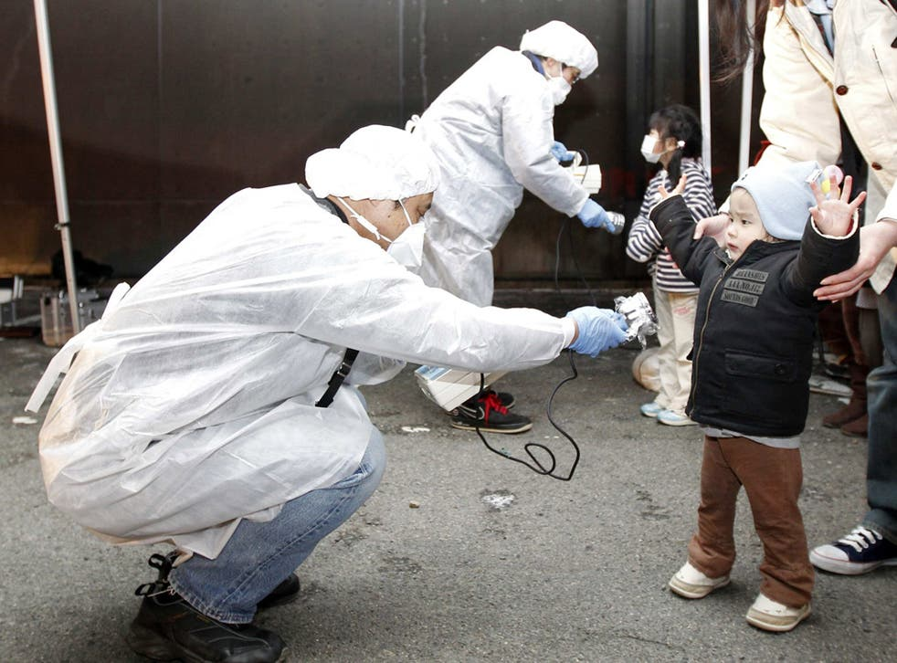 Checking for radiation near the Fukushima plant two days after the tsunami struck