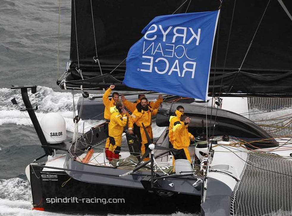 All smiles as Yann Guichard and the crew of the 70-foot trimaran Spindrift cross the finish of the Krys Ocean Race from New York to Brest