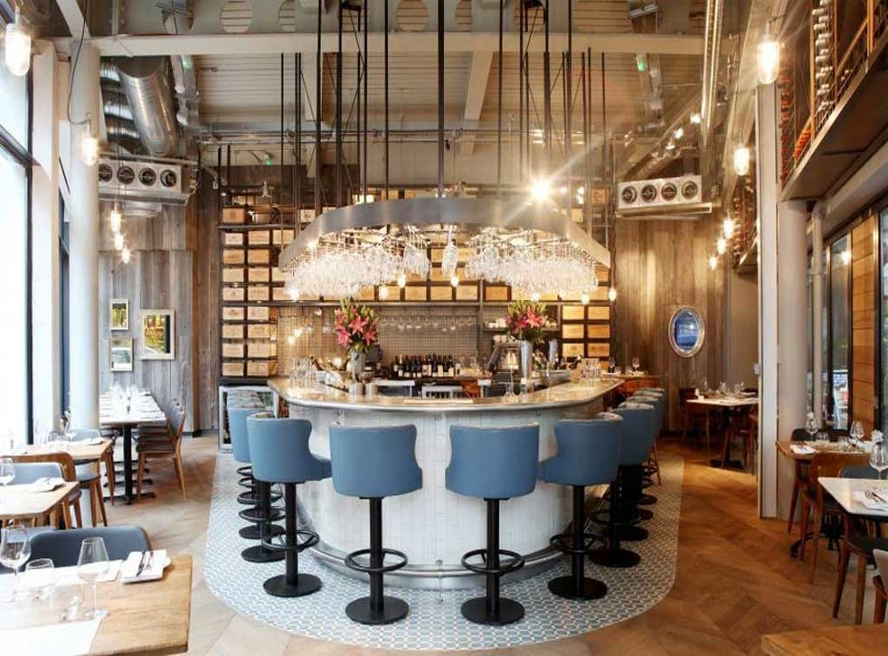 28° - 50° features a beautiful triangular bar in the centre, with an army of hanging wine glasses