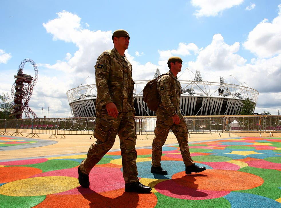 Forces personnel patrol the Olympic Park in east London yesterday