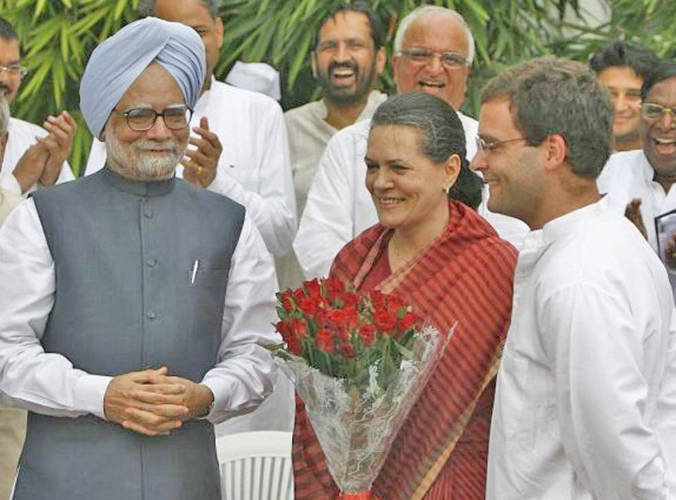 Manmohan Singh with Sonia Gandhi and her son Rahul, right, who is seen as PM-in-waiting