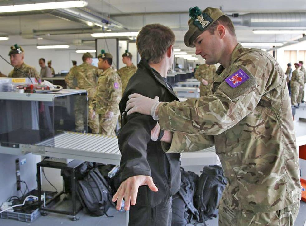 A man is searched by British military personnel at a security check point on arrival at the Olympic Park