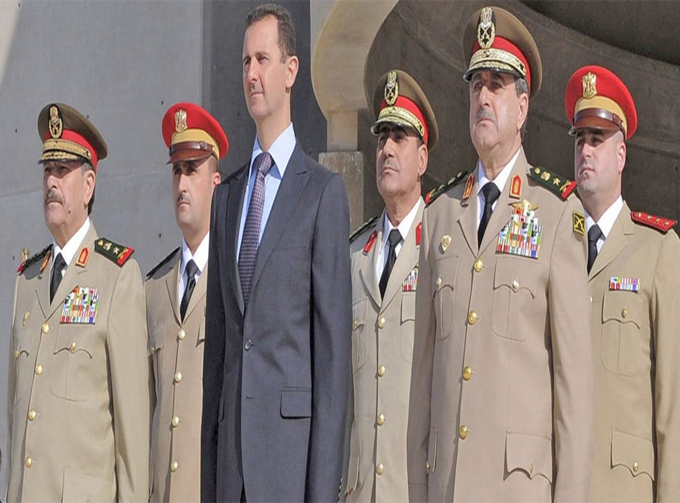 Senior regime figures reported to have been killed in yesterday's blast in Damascus include Dawoud Rajha, Syria's Defence Minister, shown, second from right, at a ceremony with President Assad last October