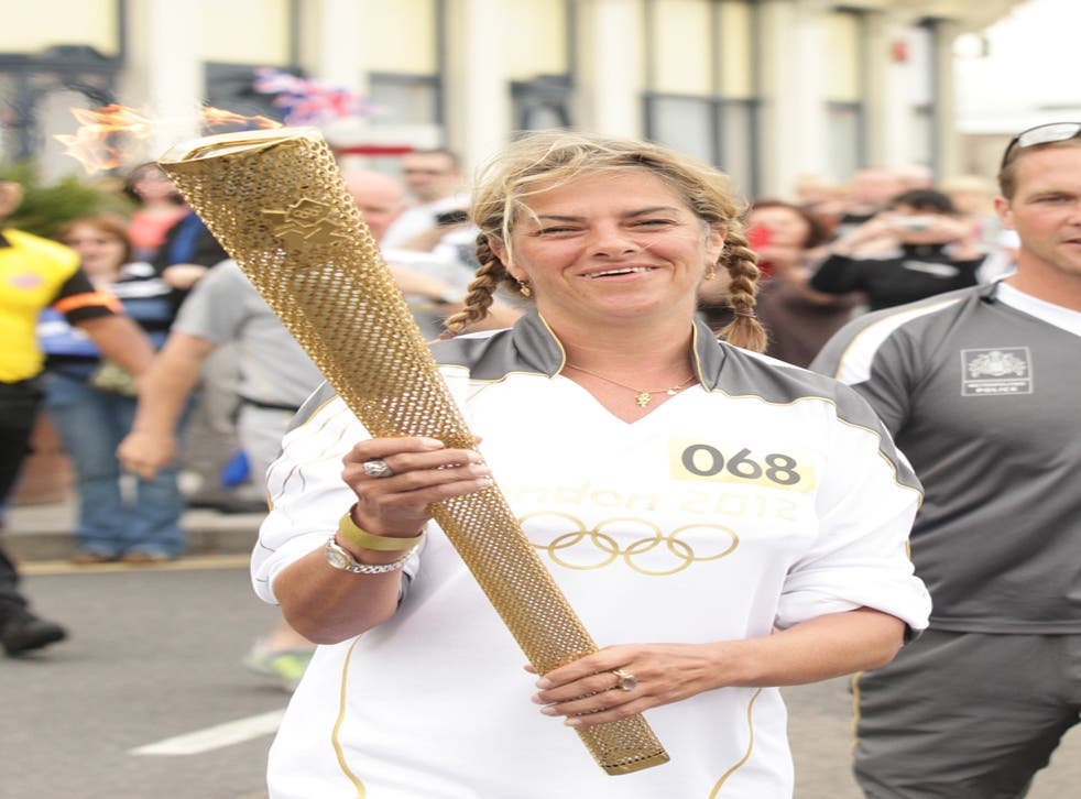 Tracey Emin carried the Olympic torch through Margate, Kent