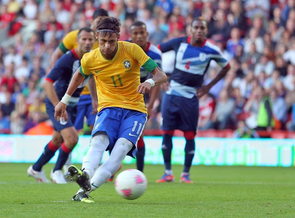 Neymar of Brazil scores