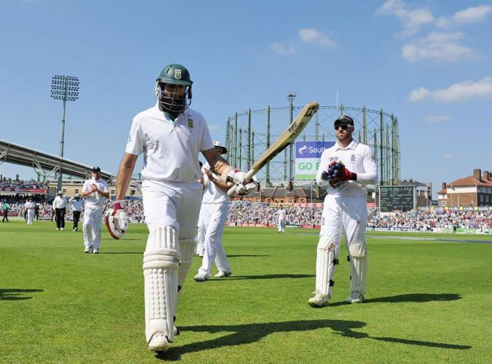 Hashim Amla, of South Africa, is applauded off the field after his unbeaten 311