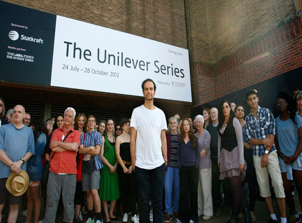 Artist Tino Sehgal is photographed with participants outside Tate Modern in London.