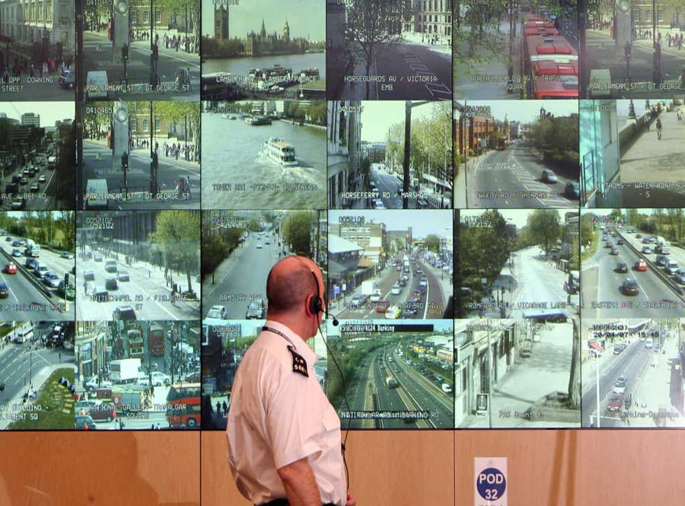 Middle-class crime and punishment: Police officer observing CCTV camera network