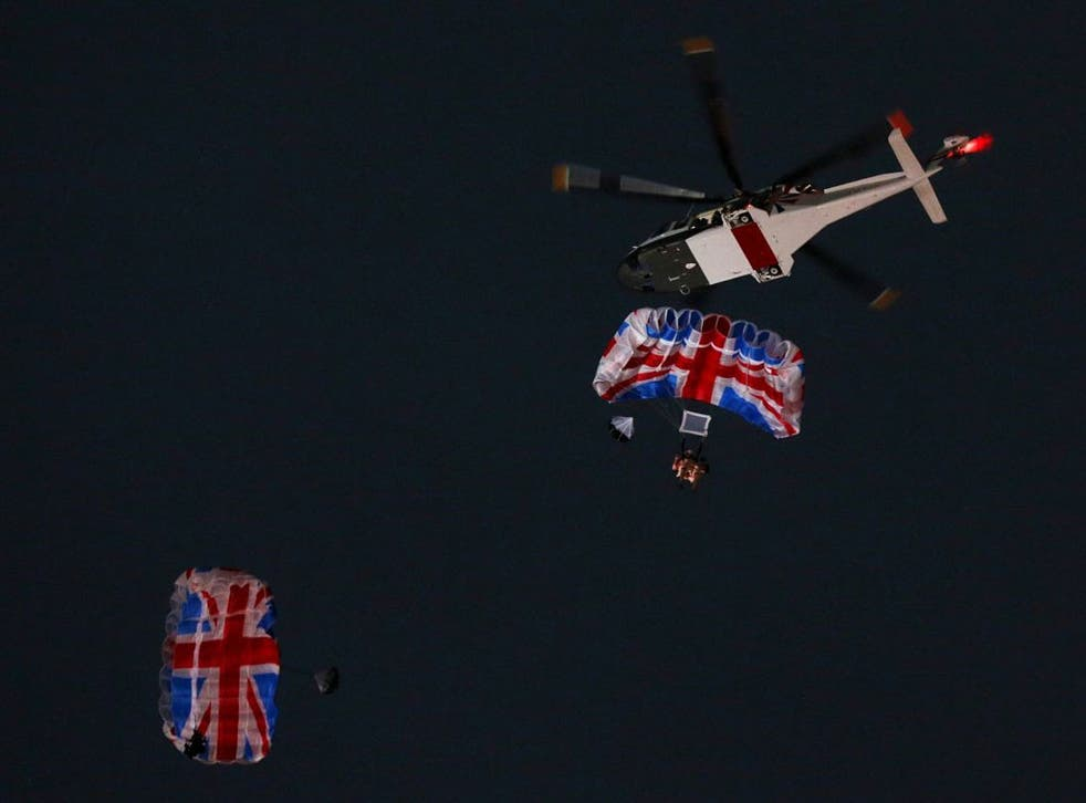 'The Queen' and James Bond parachute into the stadium