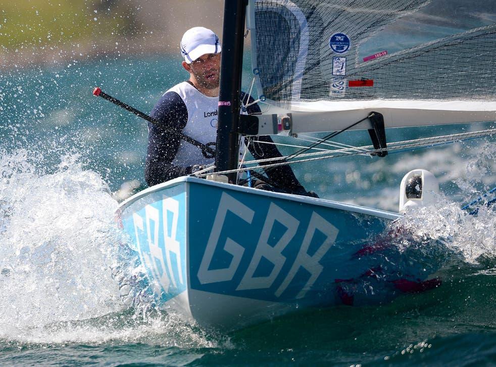 Britain's sailor Ben Ainslie crosses the finish line in a Finn class practice race