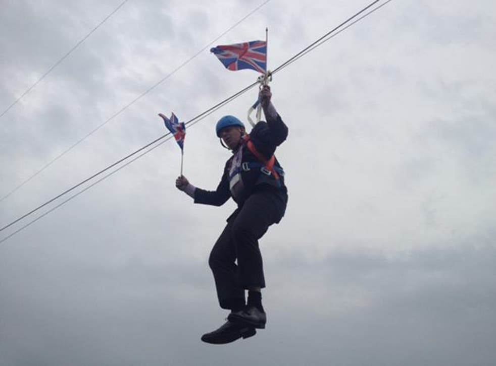 Mr Johnson was the first person to use the 45-metre high, 320-metre long zip wire zip wire which offers views towards the Olympic stadium.  (pic via Rebecca Denton)