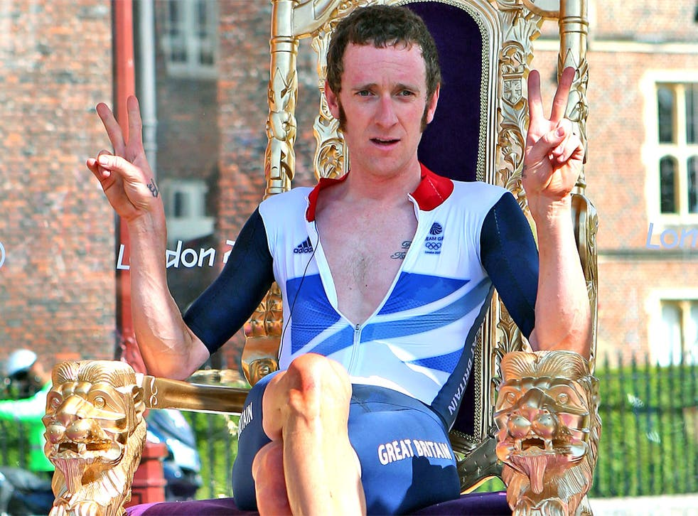 Olympic gold medallist Bradley Wiggins has called for cycling helmets to be made compulsory
