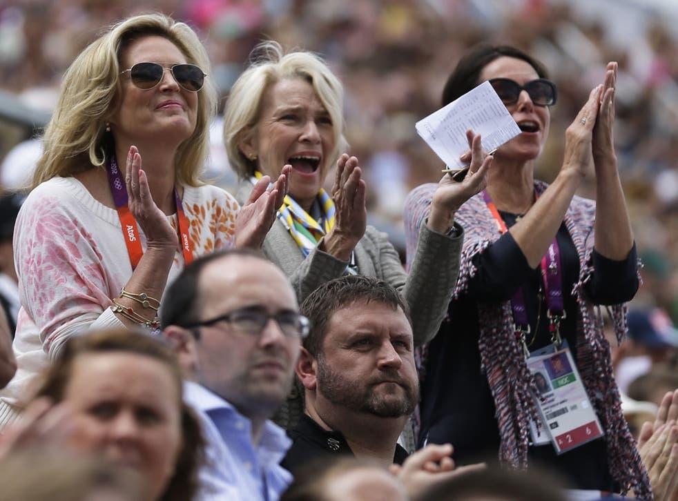 Ann Romney, far left, applauds her horse, ridden by Jan Ebeling