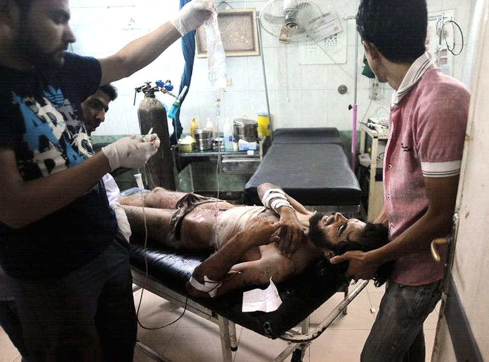 Medics defy the regime and treat a wounded Syrian rebel in a hospital near Aleppo