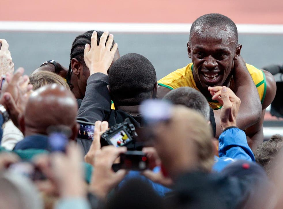 Usain Bolt celebrates his victory in the 100 metres