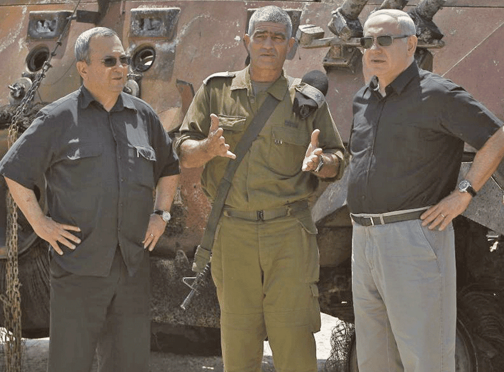 Prime Minister Benjamin Netanyahu, right, with Defence Minister Ehud Barak, left, and military commander Tal Russo, at the attack site