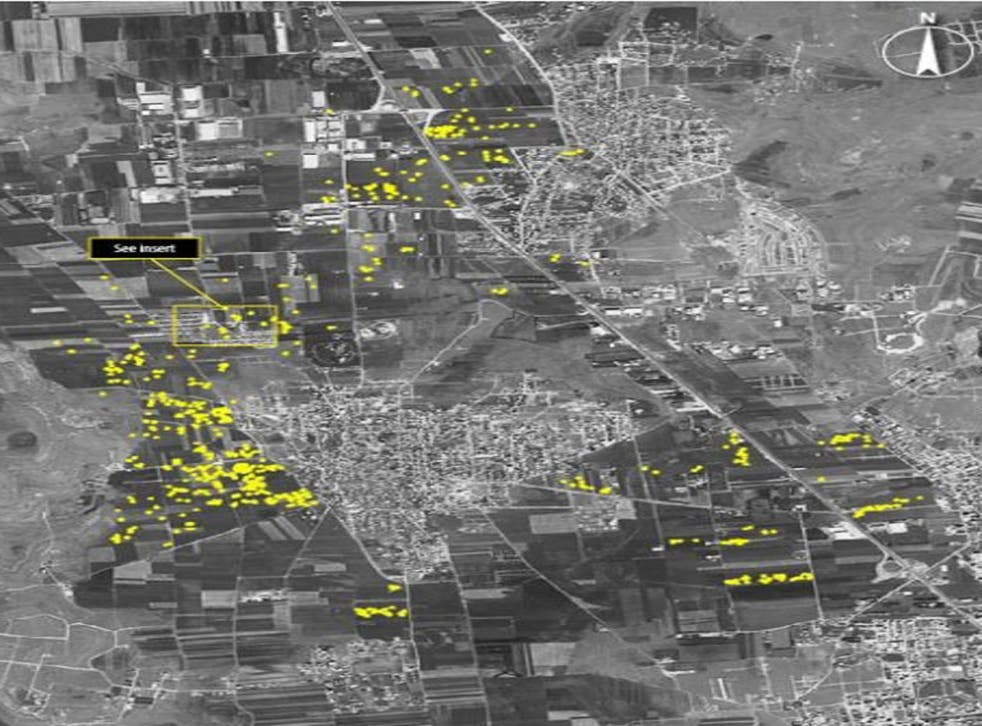 This satellite image shows what Amnesty International believes are 600 probable artillery impact craters from heavy fighting between Syrian armed forces and armed opposition groups in the village of Anadan