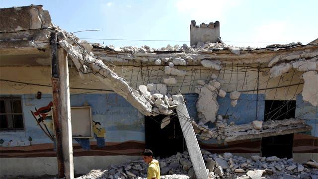 A school destroyed by an air strike near Aleppo