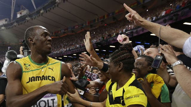 Usain Bolt celebrates winning 200m gold with his adoring fans