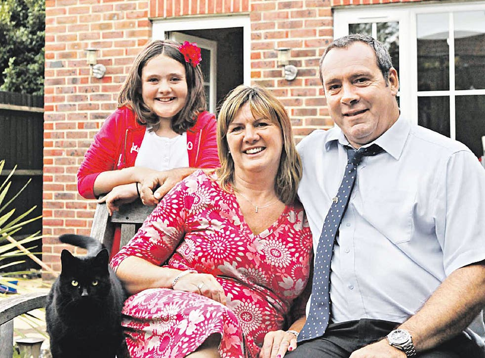 Alive and kicking: Andy Goode, who now raises money for pancreatic cancer research, with his wife Kate and daughter Rachel