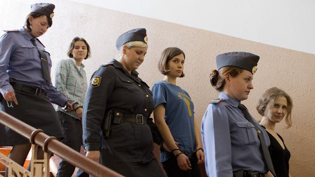 Members of the Russian punk band Pussy Riot were given two-year jail terms for protesting against President Vladimir Putin on the altar of Moscow's main cathedral
