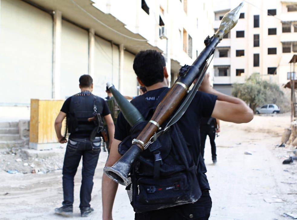 The Free Syrian Army secures a street in the Damascus suburb of Saqba
