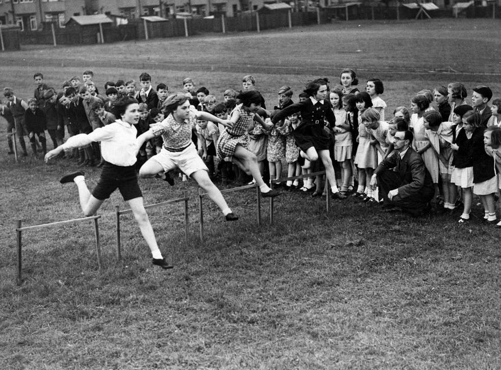 Leap of faith: Many would like to see a return to school sports such as this 1935 race