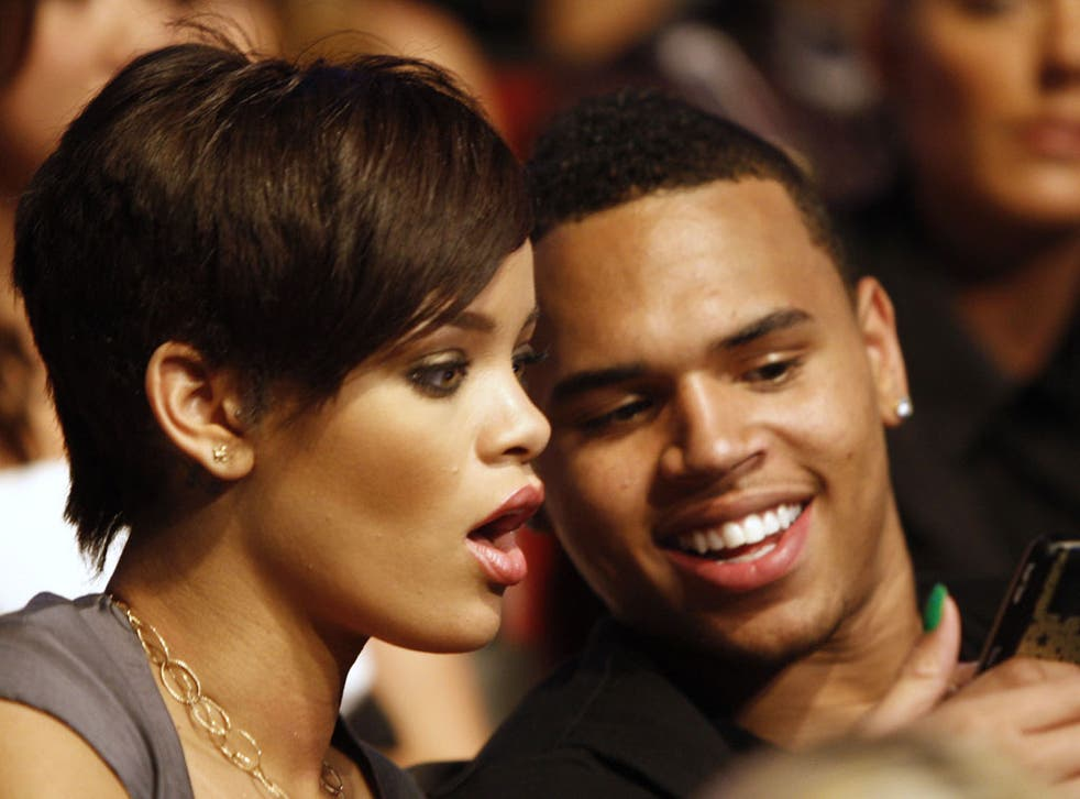 Forgiving: Rihanna with Chris Brown in 2008, before he attacked her
