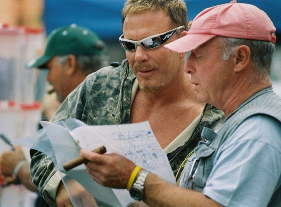 Scott with Mickey Rourke on the set of his 2005 film 'Domino', one of the director's most restless, hyperactive works
