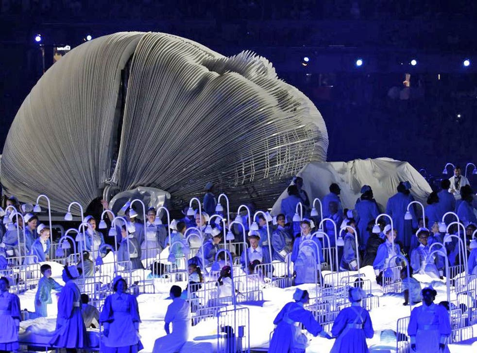 Actors perform in a sequence meant to represent the NHS during the opening ceremony at the London Olympics