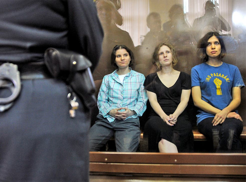 Pussy Riot's members await their fate during a court hearing in Moscow