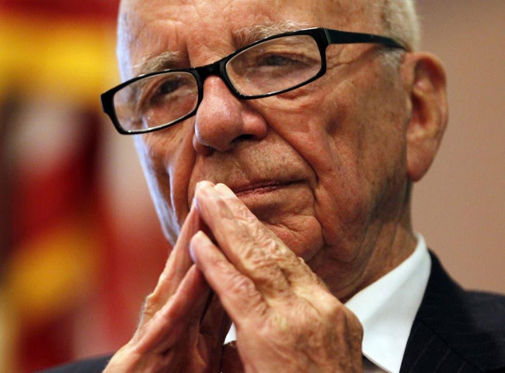 Murdoch: saw initial failure to run the photos as 'humiliating'