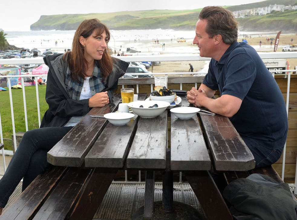 Mussel beach: David Cameron and his wife Samantha have lunch by the sea at Polzeath, Cornwall, yesterday