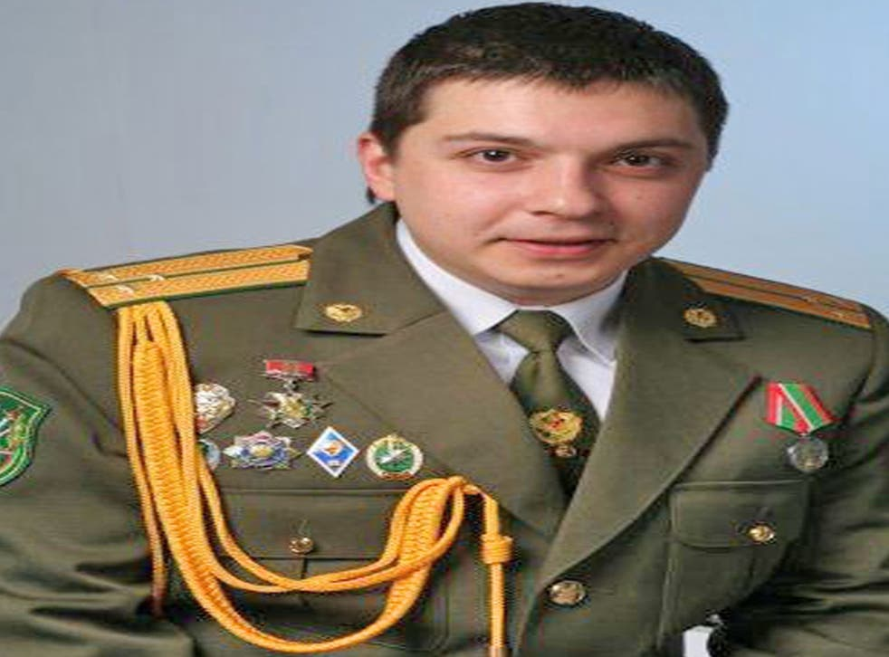 Aliaksandr Barankov poses in his Belarus military uniform