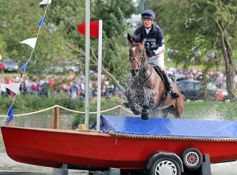 William Fox-Pitt tackles one of the Burghley fences yesterday