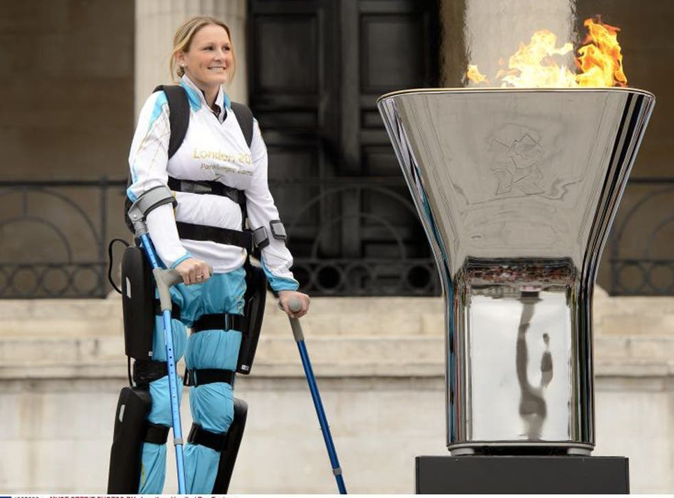 Claire Lomas with the Paralympic flame in Trafalgar Square