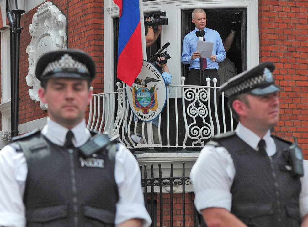 Julian Assange addressing supporters last month from the Ecuadorian embassy where he has sought refuge