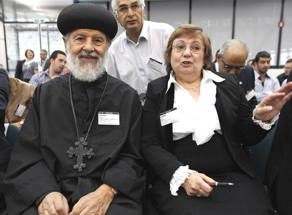 Nadia Eweida with Bishop Athanasios Canepa at the European Human Rights Court in Strasbourg yesterday
