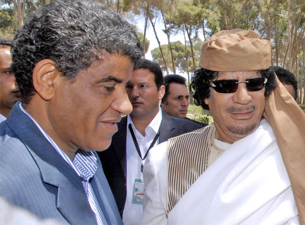 Abdullah al-Senussi, pictured with Gaddafi