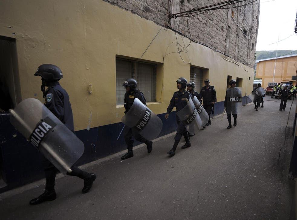 Riot police in the Honduran capital Tegucigalpa