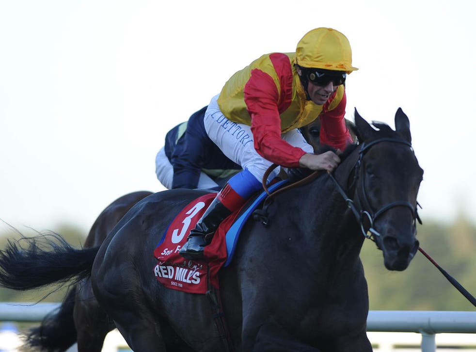 Frankie Dettori urges Snow Fairy to quicken to victory in the Irish Champion Stakes at Leopardstown